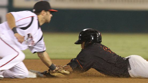 Billy Hamilton evades the tag for his 100th stolen base this year.